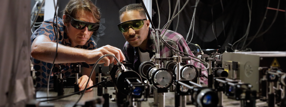 Graduate student and his faculty mentor work together to set up a two-photon microscope