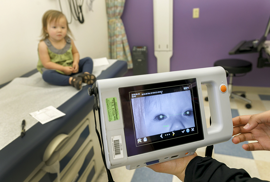 A simple device can take a picture of a child's eyes to find vision problems.