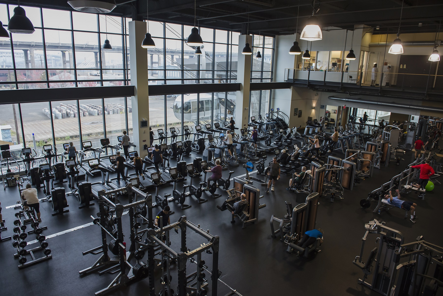 Wide view of fitness floor showing cardiovascular and strength equipment.