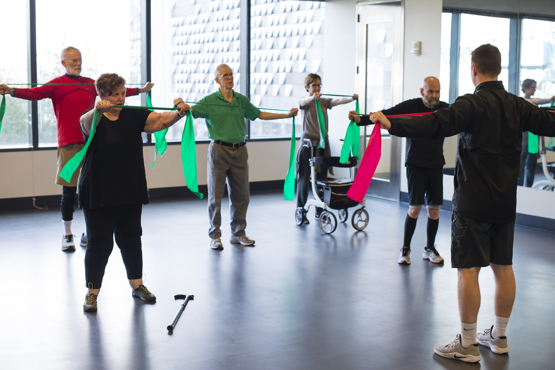 Six participants following instructors directions for exercises in a Parkinson's class.