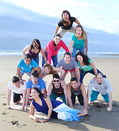Department of Neurology residents enjoy a retreat at the Oregon Coast, stacked into a human pyramid