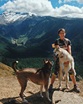 Sierra Lavoy, B.A., outdoors, with dogs