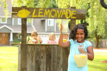 little girl selling lemonade with friends