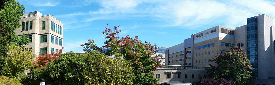 A sunny day view of the OHSU campus, with the hospital on the right