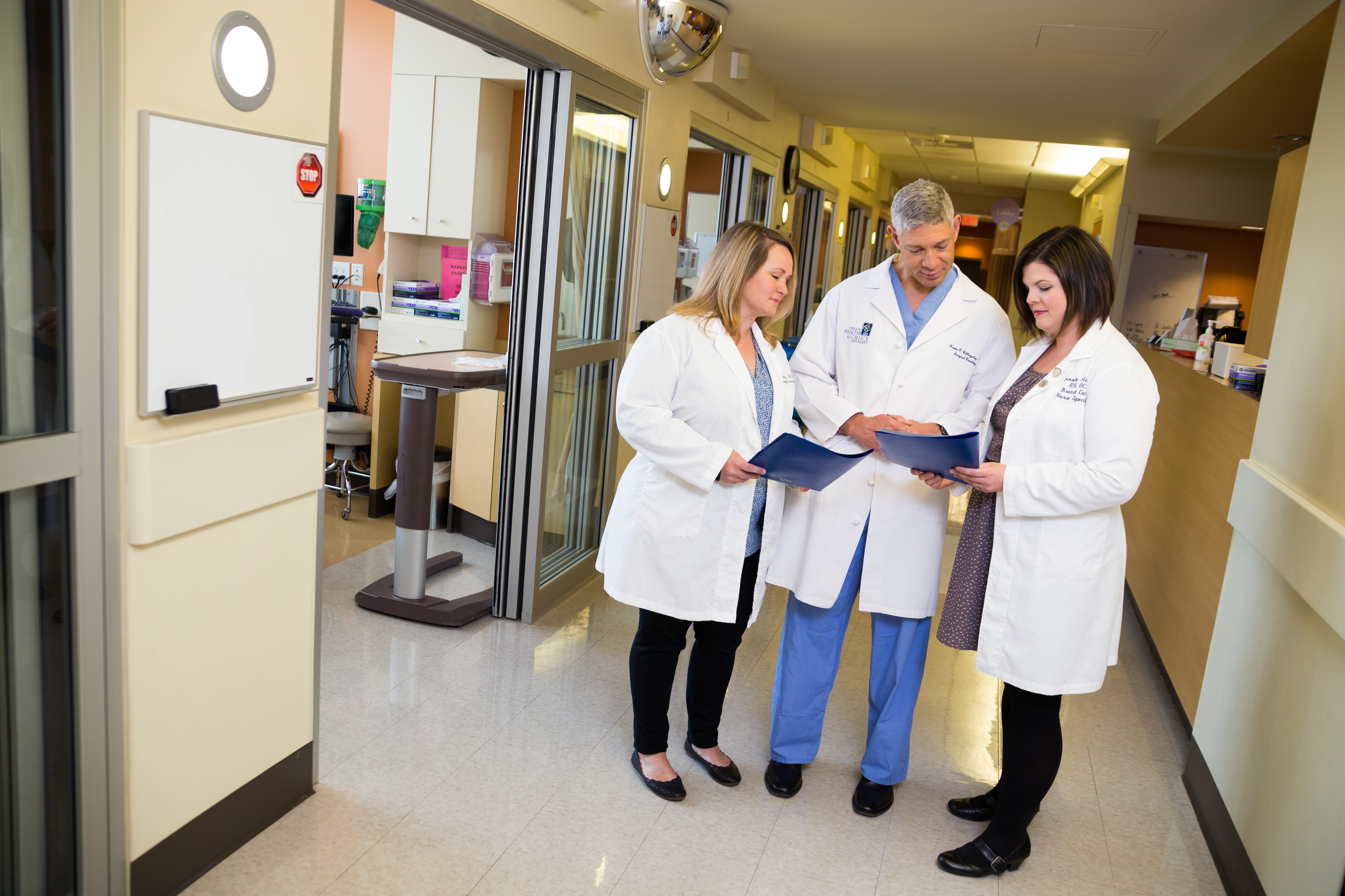 Dr. Kevin Billingsley (middle) consults with nurses Molly Barbar (left)  and Brooke Hambly.