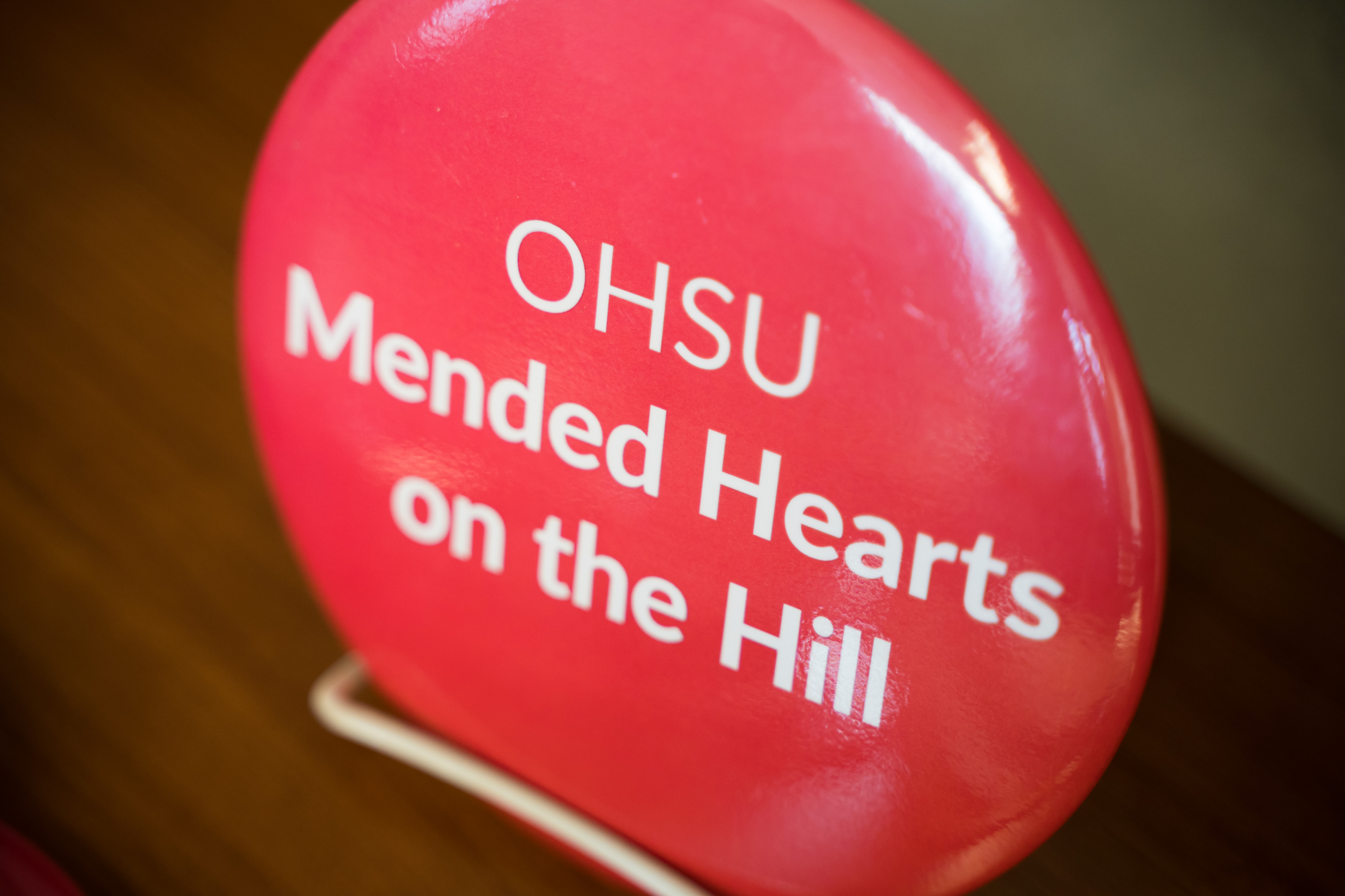 Large button that says OHSU Mended Hearts on the Hill