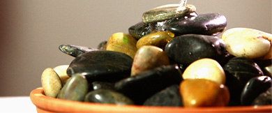 A bowl containing a pile of smooth river stones