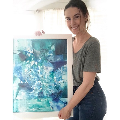 Artist-in-Residence Jessica Trottier displays work of art, a blue and green abstract.