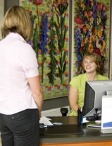 An OHSU Center for Women's Health patient is greeted by the clinic receptionist at check in.