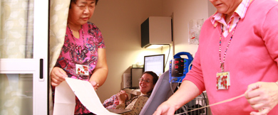 OHSU care provider team reads data generated by a fetal monitoring instrument
