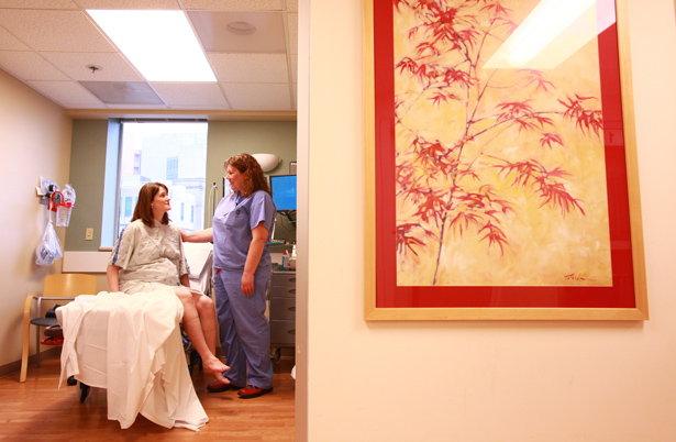 An expectant mother prepares for delivery in a birthing suite with an OHSU provider standing by