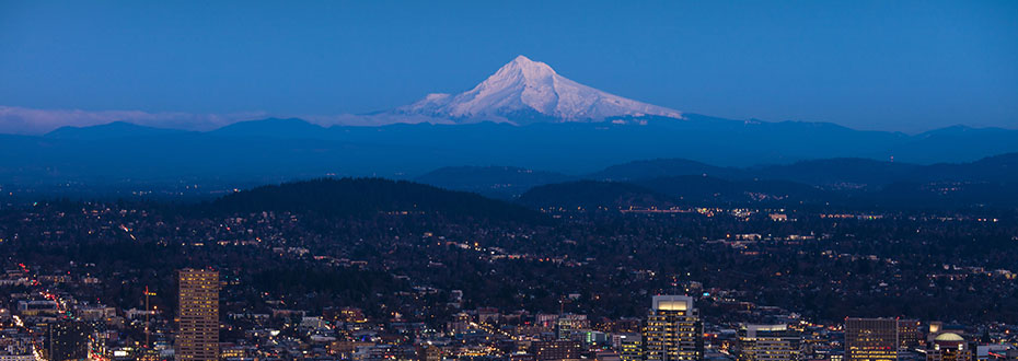 Skyline view of Portland at night with Mt. Hood in the background