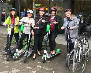 Moore Institute employees on electric scooters