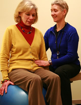 Sandi Gallagher, therapist, works with a patient in rehabilitation therapy