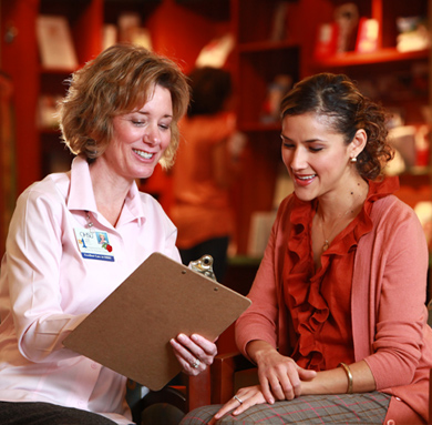 An OHSU care provider explains documentation to a patient