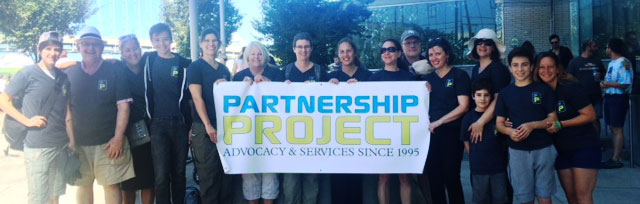 Partnership Project team group photo at AIDS Walk Portland, with Partnership Project banner