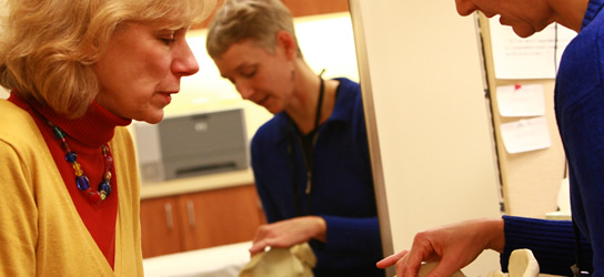 Sandi Gallagher, therapist, speaks with a patient