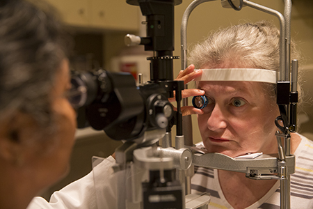 A woman having an eye exam