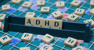 a scrabble game that spells out ADHD