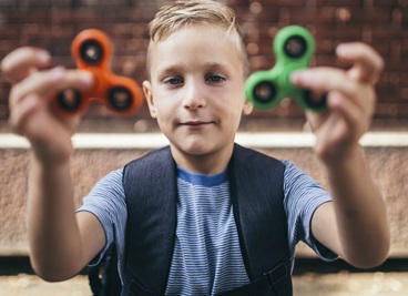 Child with 2 Fidget Spinners