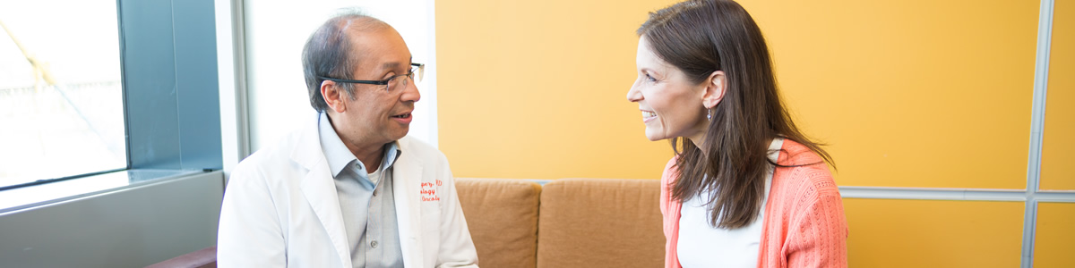 OHSU provider, Dr. Charles Lopez, speaks with a patient in the Hematology Oncology patient waiting room