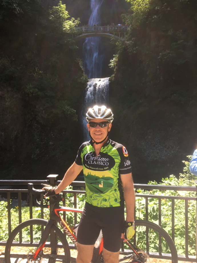 Dr. Wilson poses with his bike at Multnomah Falls on his Tour de Casey ride.