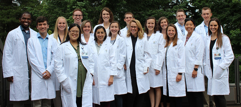 Group photo of the PGY-1 Resident Class in their white coats.