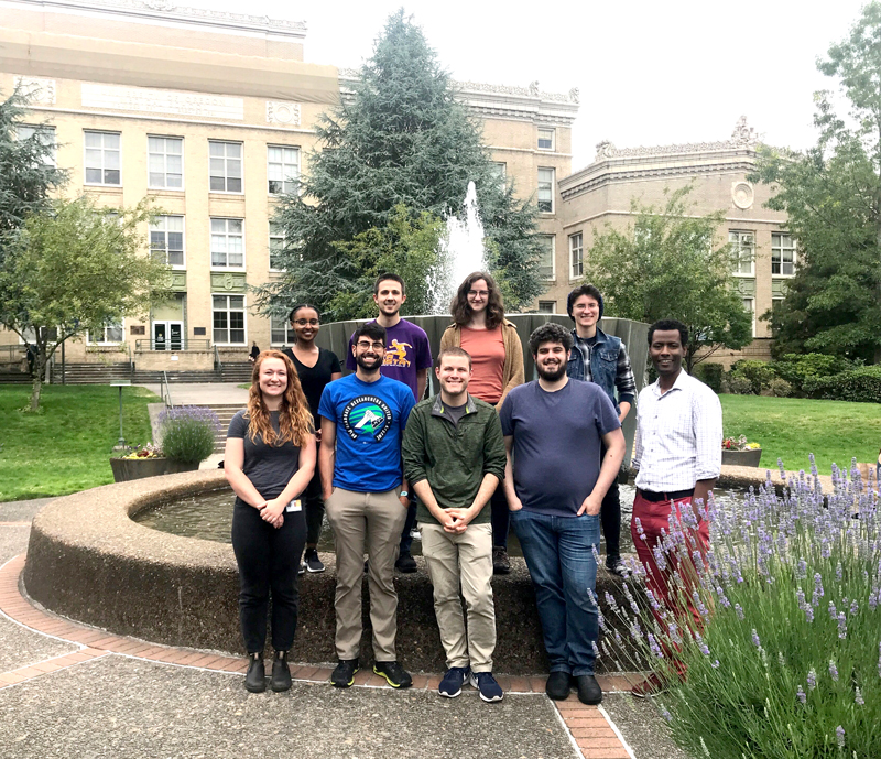 Tafesse Lab in front of the fountain outside of Mackenzie Hall.