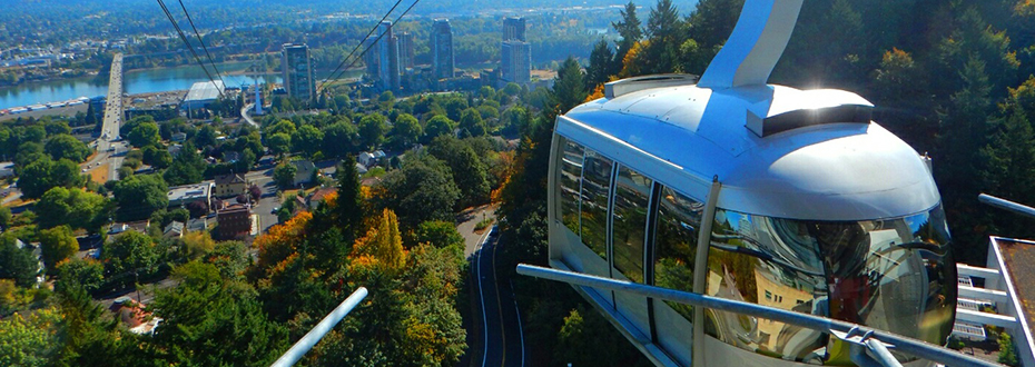 The Portland Aerial Tram arriving at OHSU's Marquam Hill on a sunny morning in summer.