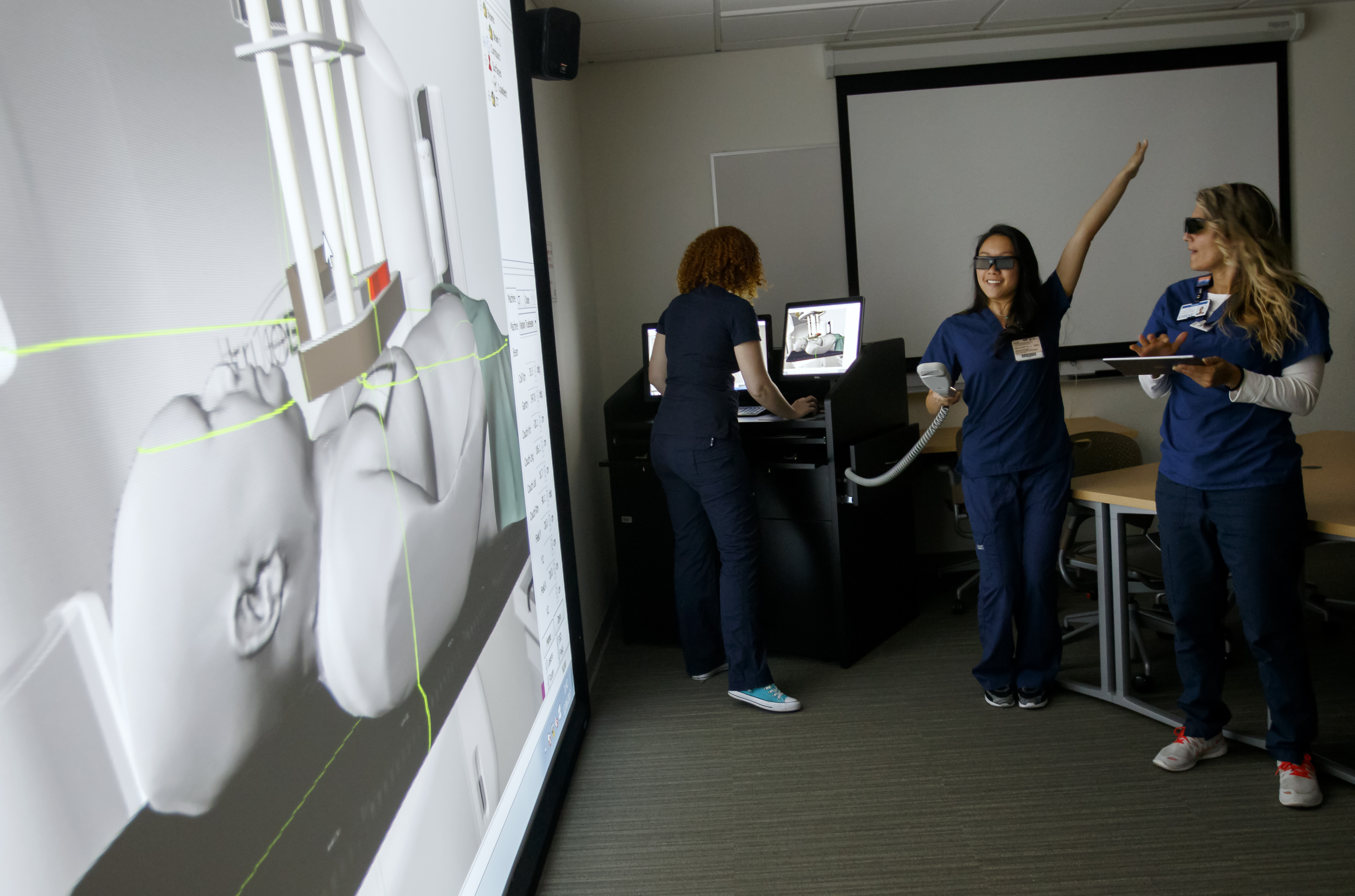 Radiation Therapy students using simulation interactive program