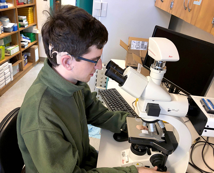 Brendan Cramer interned at OHSU to help scientists learn more about stem cells as a possible treatment for Usher Syndrome, which Creemer has.