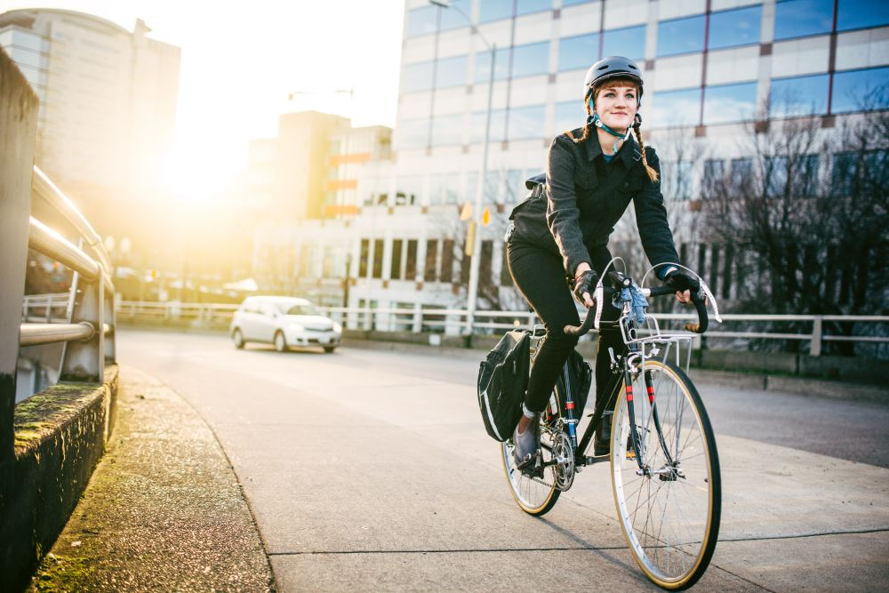 Woman commuting on a bicycle in an urban area.