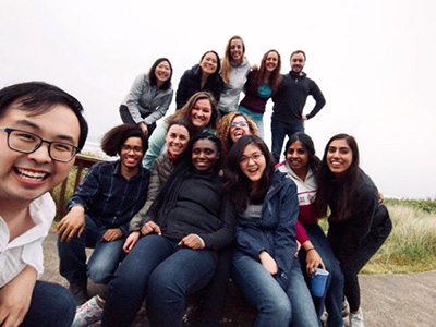 Department of Neurology residents posed in pyramid style, enjoying their retreat at the Oregon coast