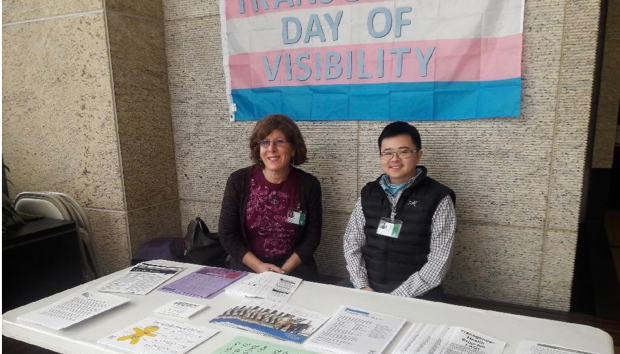 Jean Bryant and Mic Chan, both volunteers with the OHSU Transgender Health Program, staff a table on the OHSU campus for Transgender Day of Visibility.