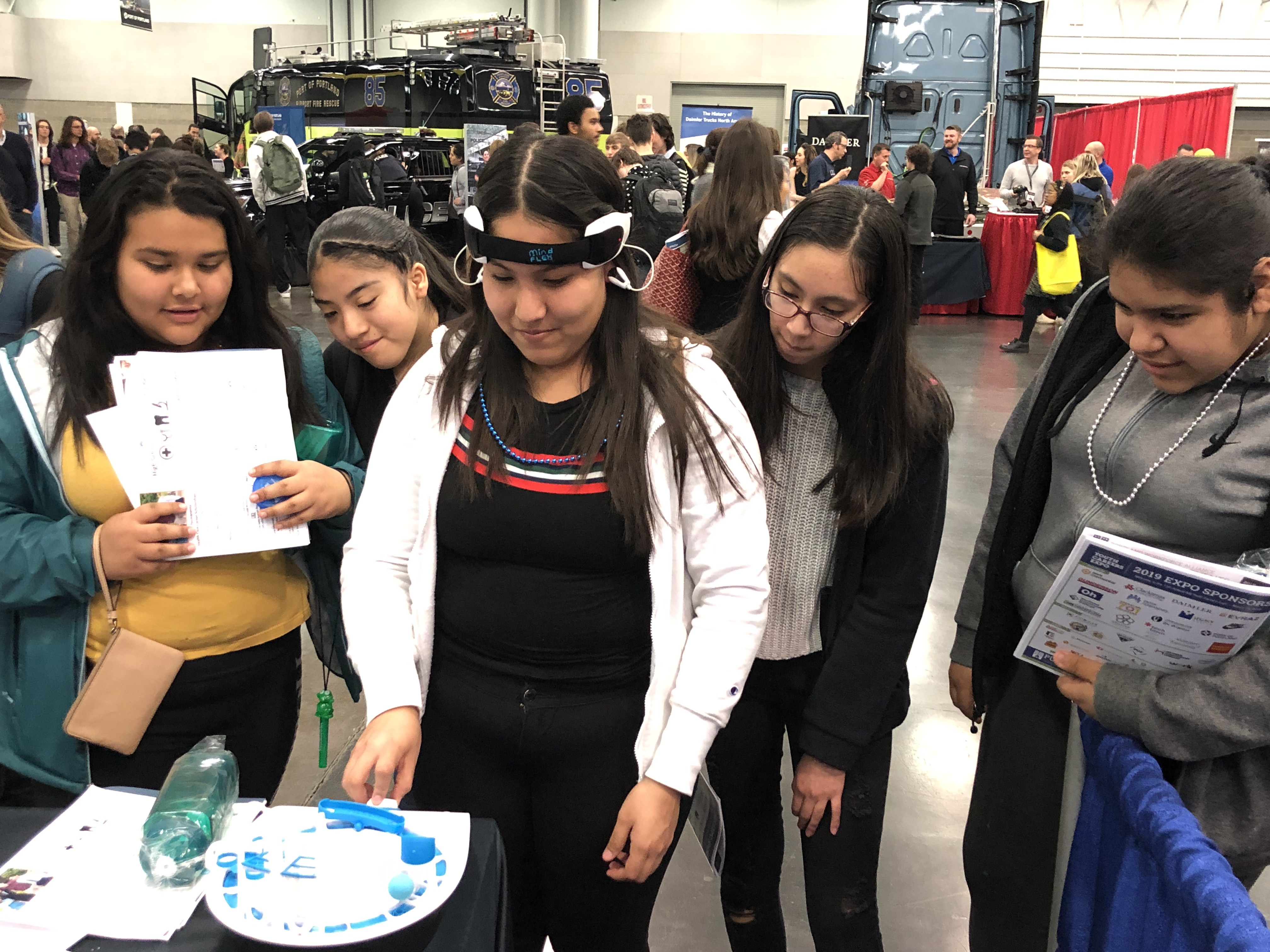Students visit the YES! booth to play a mind-control game at the NW Youth Expo