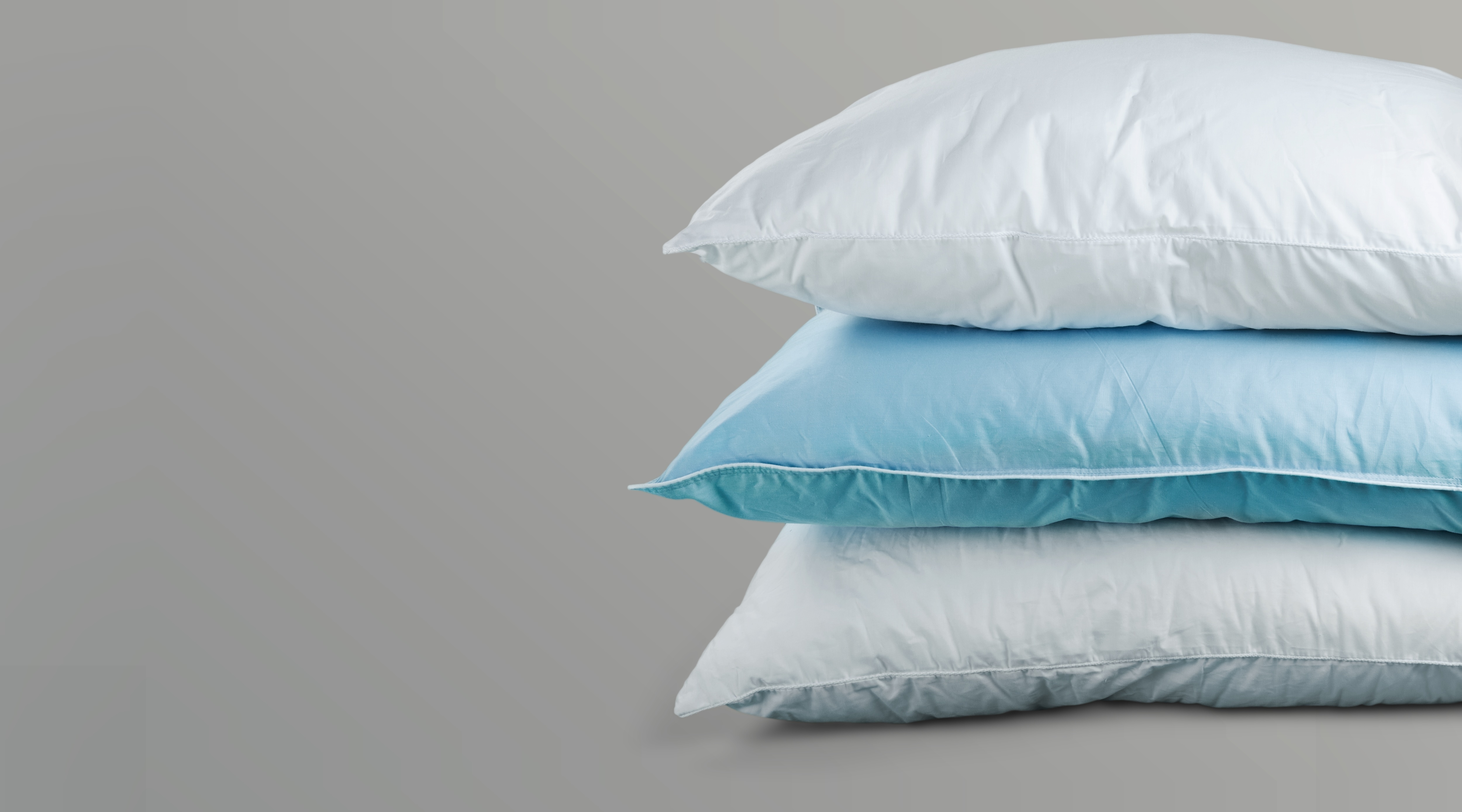 Stack of blue and white pillows