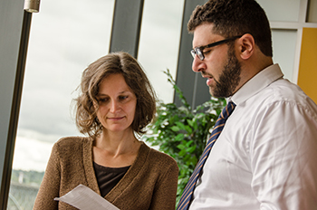 Dr. Eva Medvedova, a blood specialist, confers with Dr. Karam. OHSU's program to care for patients with amyloidosis, a rare blood disorder, brings a wide range of specialists together.