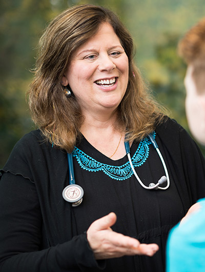 Dr. Natasha Polencek speaks with a primary care patient
