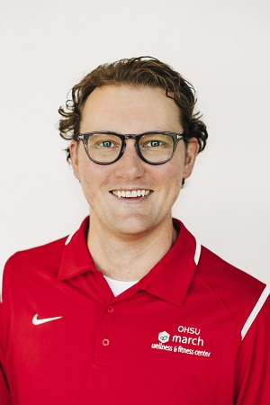 Nick Parker image with glasses and red jacket