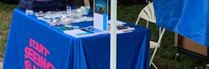 An image of a Start Seeing Melanoma table at an event