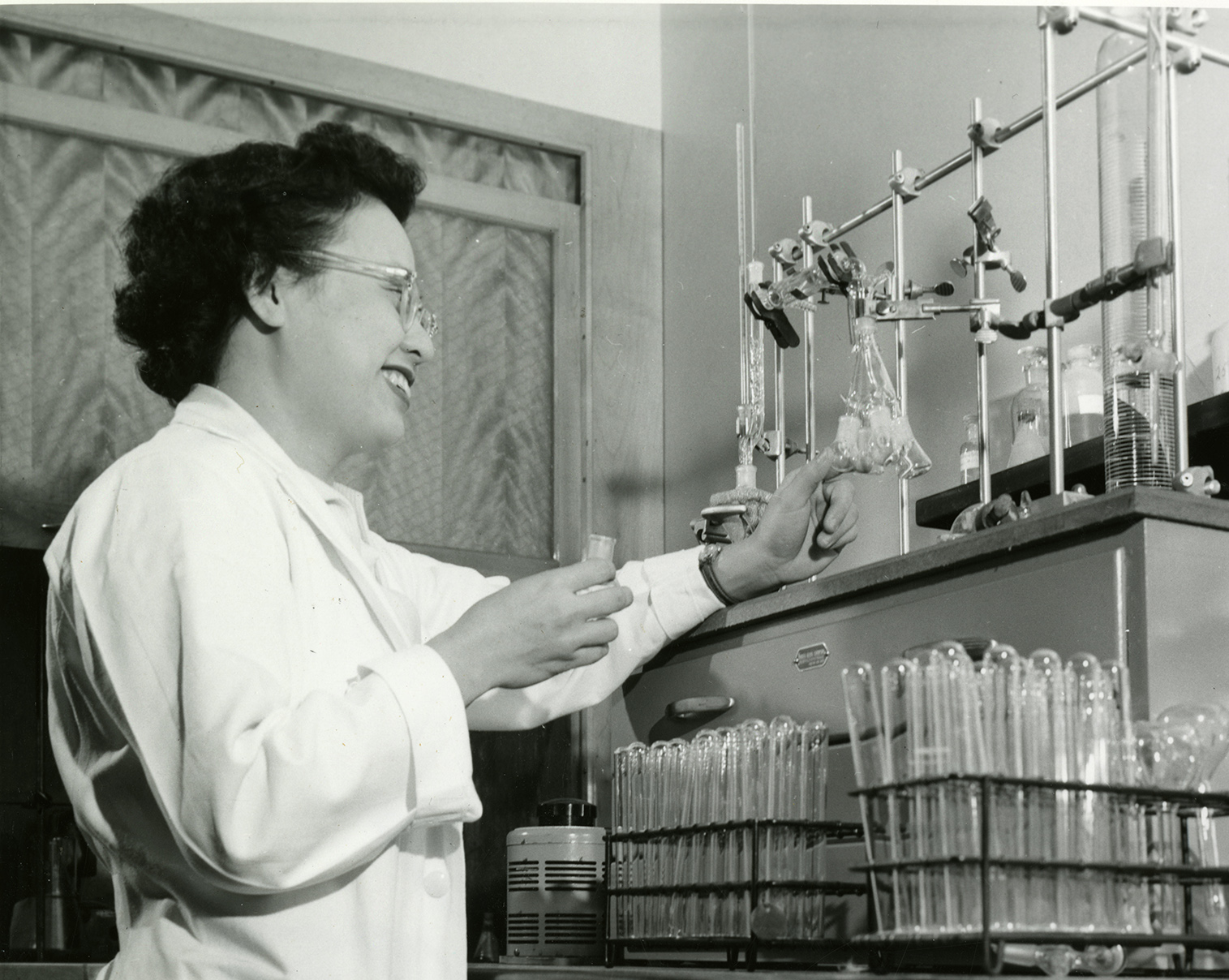 Rose Wong, Ph.D., works in a biochemistry lab with pipettes