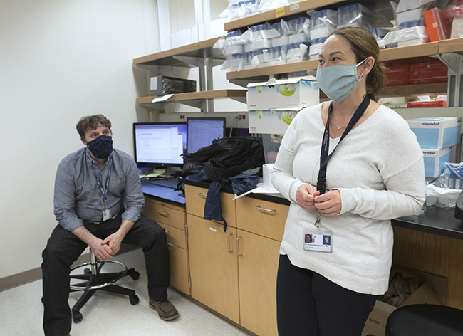 Daniel Streblow, Ph.D., (left) and Donna Hansel, M.D., Ph.D., work in OHSU's in-house COVID-19 testing lab.