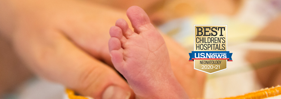 "A close up of a baby's foot with an adult hand around its ankle, with a U.S. News & World Report badge imposed on top of the photo, that reads ""Best Children's Hospitals 2020-21"" specifically in the field of ""Neonatology."""