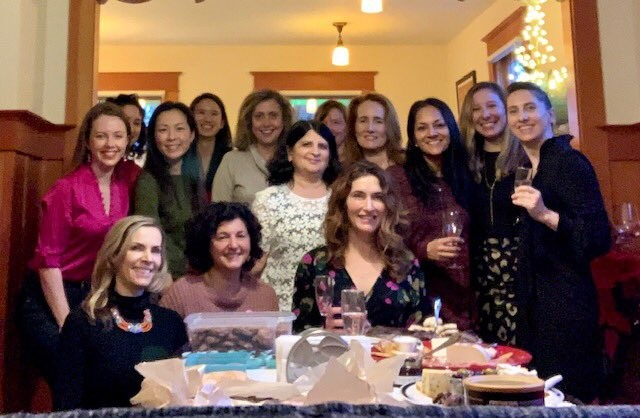 Diagnostic Radiology Women in Radiology Group picture gathered at someone's house.