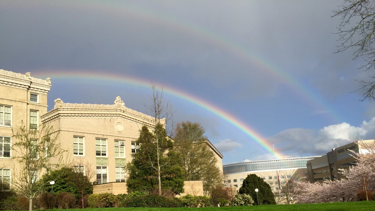 Double rainbow over Baird Hall with the OHSU Hospital in the background