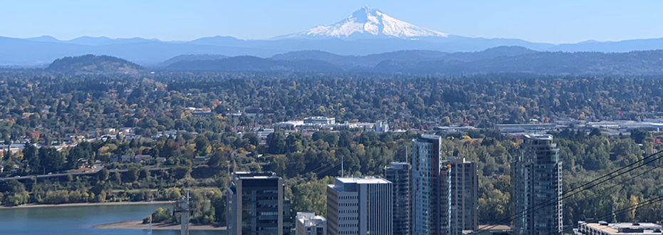 A scenic photo taken from OHSU looking out at Portland's South Waterfront and Mt. Hood in the background.