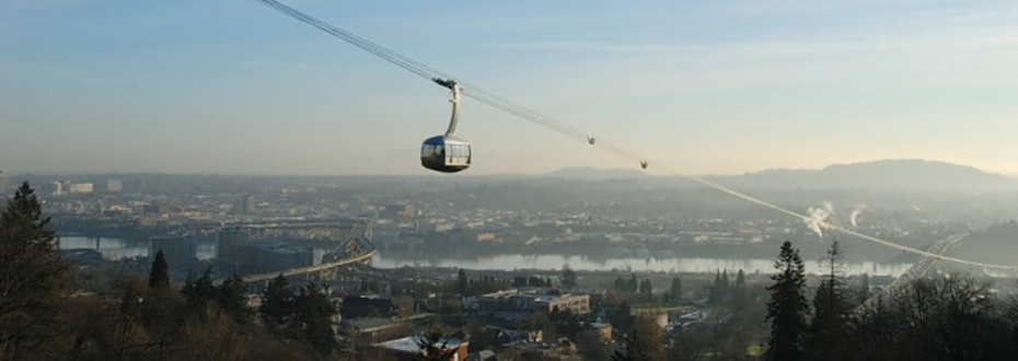 A scenic photo of the OHSU tram shutting up Marquam hill in the morning.
