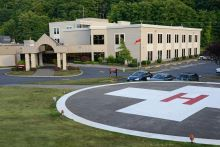 photo of a hospital entrance with outdoor ground level helipad