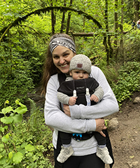 A woman with her baby on a hike.