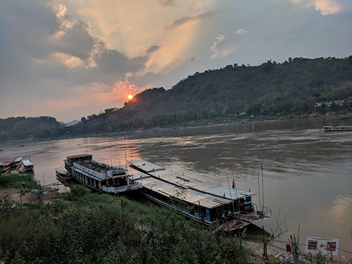 An image of a river at sunset in Laos.